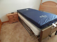 Electric hospital bed with mattress