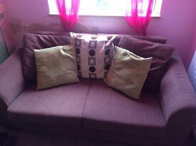 Two seater chocolate sofa
