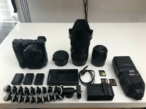 Sony a6300 + sigma 18-35 + 50mm 1.8 + Battery grip + accessories