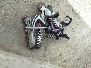 Barely used size 8 Bauer roller blades with 2 hockey sticks