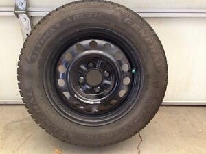 4 like new 195 65R15 studded winter tires on 4x114.3 steel rims.