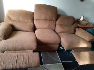 Free couch with two reclining sections.