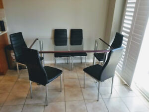 Modern Glass kitchen table with 6 leather chairs.