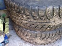 Studded tires. Barely used with rims