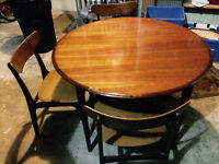 Mid-century modern teak extendable dining table with four chairs