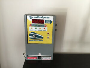 Coin operated breathalyzer