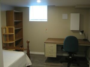 A room in newly built large 3-bedroom basement apartment