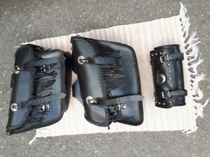 Leather throw over saddlebags and tool pouch.