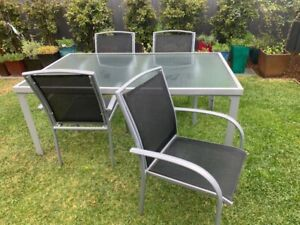 Outdoor table and 4 chairs (sold together)