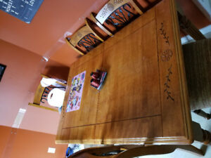 Kitchen table with leaf and 6 chairs. Good solid table