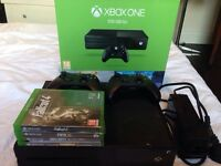 Xbox one 500gb with 2 controllers and 4 games