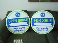 """Property Guys"" signs to sell."