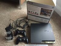 250GB Playstation 3, 2 controllers, charging dock & 10 games