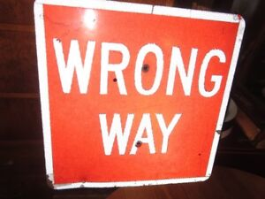 a VINTAGE METAL WRONG WAY TRAFFIC SIGN USED IN GOOD CONDITON