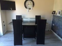 Large glass extending table & 6 matching chairs