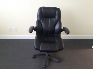Office chair with fold up arms