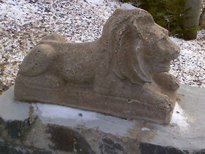 Two Laying Concrete Lion Statues