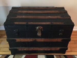 antique black and wood trunk