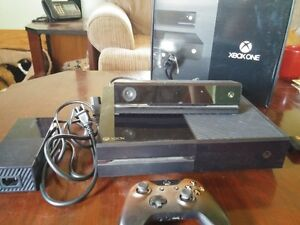 Xbox One w/ Kinect and play and charge kit.