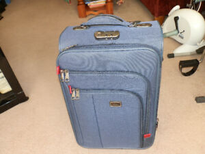 Selling Tessero Brand  suitcase with lock.