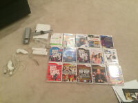 Wii Game unit with lots and lots of Games and two controllers
