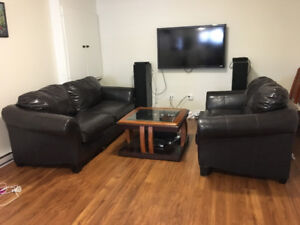 Two Black Leather couches & Coffee Table