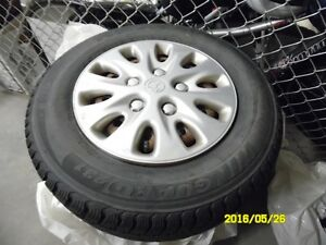 4 (14 in)  WINTER TIRES WITH RIMS FOR SALE