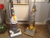 Two vacuum cleaners dc15 and dco1