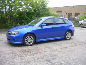 2010 Subaru Impreza awd-  Rally blue- 5 speed manual