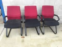 Red and black reception chairs