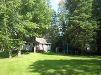 3 bedroom waterfront cottage - HOT TUB, Kayaks, Canoe and more..