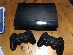 PS3 Super Slim + 2 Controllers & 21 Games