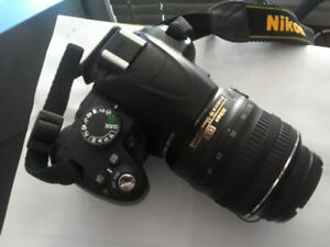 Nikon D3000 DSLR Camera with AF-S 18-55 MM VR Lens