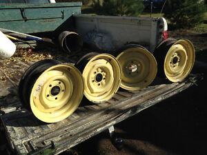 4 14x5 inch Ford rims 41/4 inch center to center of holes $50