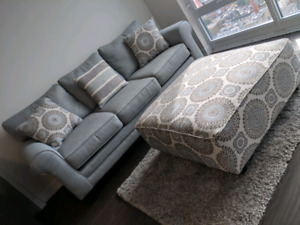 Three seater sofa with matching ottoman and pillows