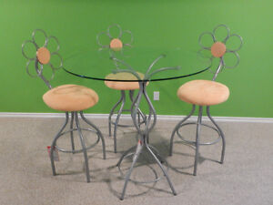 3 barstools with glass table