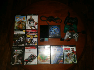 PS2 + Controllers + Games + Storage Cards