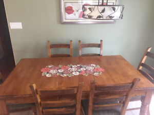 Moving must sell: solid wood dining table ; made by Ashley