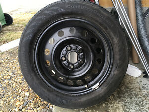 4continental P205/55 R16 89HM tires with 16 in rims and hubcaps