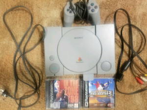 Playstation with controller, 2 games and a memory card