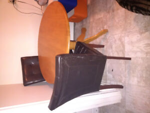 Hardwood kitchen table and 4 leather chairs to sell