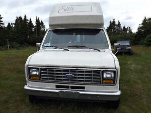 1990 roomy but uses regular parking, factory van camper