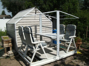 White glider swing with table.