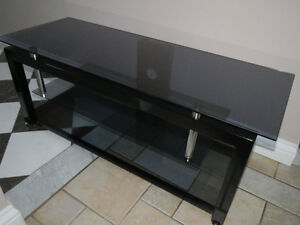 TV stand .  Steel with 3 glass shelves