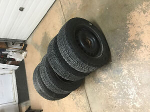 For sale (4) Winterforce tires and rims (studded)