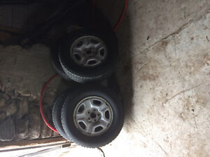 Tires and rims off a Toyota Tacoma base model