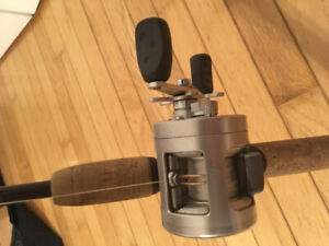Two baitcaster rods and a baitcaster reel. Fishing