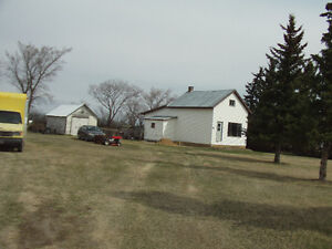 1 1/2 half story house, and 3 building and 2 sheds for sale