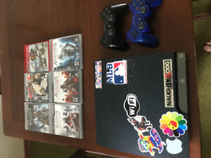 PS3 500 GB slim with 2 controllers and 6 games
