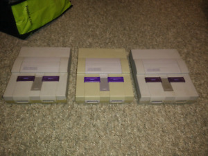 3 broken Super Nintendos